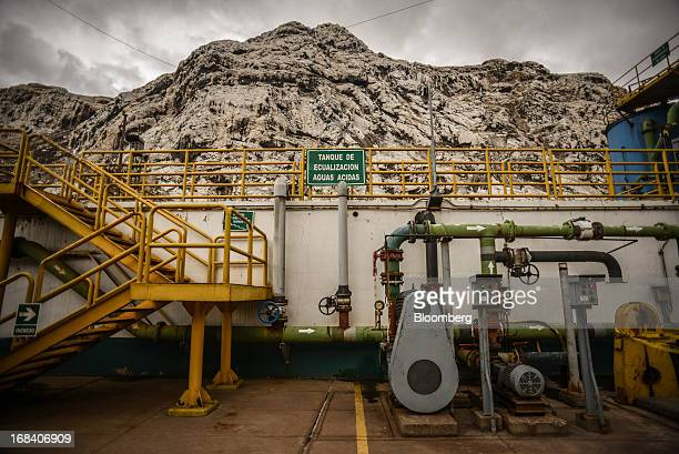 A water equalization tank sits below a polluted mountain at the Doe Run Peru refinery in La Oroya Peru on Wednesday March 20 2013 Located high in the...