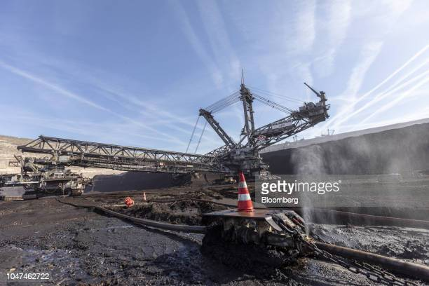 Water escapes from pipework as a giant excavator operates at the open pit lignite mine operated by RWE AG in Hambach Germany on Friday Oct 5 2018 The...