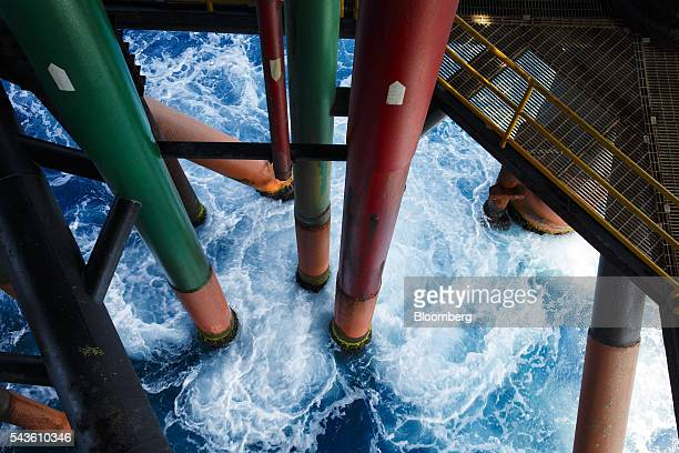 Water extraction pipes emerge the Mediterranean Sea at the Casablanca oil platform operated by Repsol SA off the coast of Tarragona Spain on Tuesday...