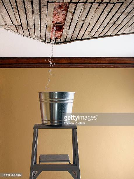 water falling from ceiling - ceiling stock pictures, royalty-free photos & images