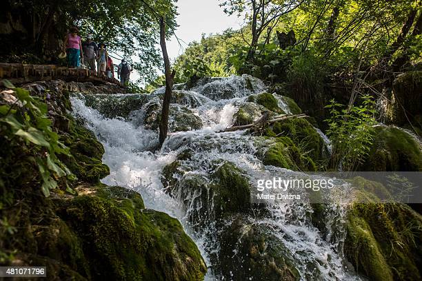 A water falls down from the Milanovac lake at Plitvice Lakes National Park on July 6 2015 near Plitvicka Jezera Croatia Plitvice Lakes National Park...