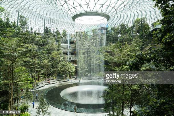 Water falls from the Rain Vortex in the Forest Valley garden during a media tour of the Jewel Changi Airport in Singapore on Thursday April 11 2019...