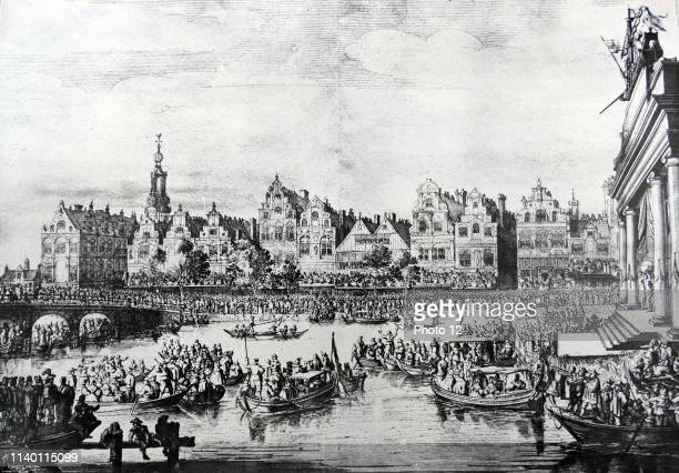 Water festival in Amsterdam during the visit of Maria de Medici Beautiful cityscapes on the Rokin with partying crowd Engraving of S Savry to drawing...