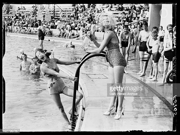 Water fight at an outdoor swimming pool 1937 A photograph of a water fight at an outdoor pool in Morecambe Lancashire taken by Saidman for the Daily...