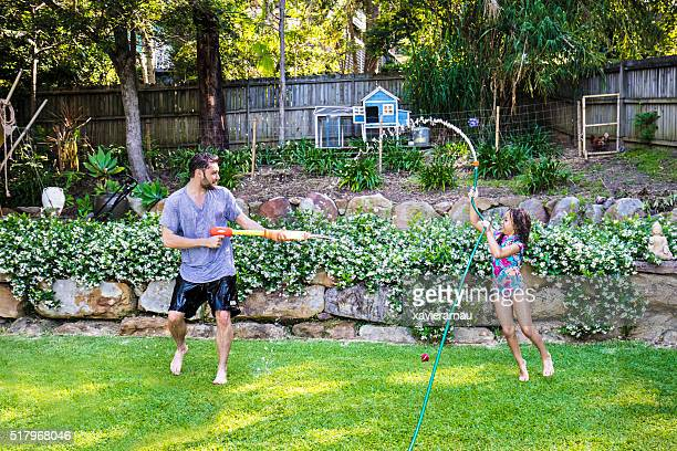 Water fight with dad