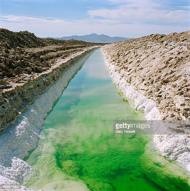 water filled canal in salt mine - amboy california stock photos and pictures