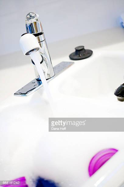 water filling white and silver sink with suds - dana white stock pictures, royalty-free photos & images