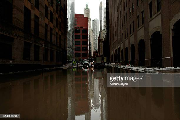 Water floods a street in October 30 2012 in lower Manhattan New York The storm has claimed at least 33 lives in the United States and has caused...