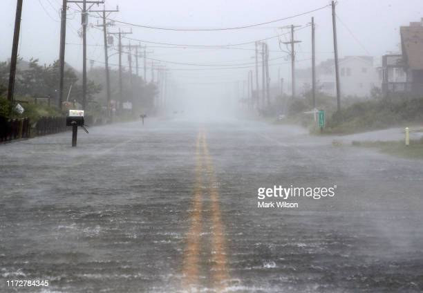 Water floods Highway 12 as Hurricane Dorian hits the area on September 6 2019 in Nags Head North Carolina Dorian passed Charleston SC yesterday as a...