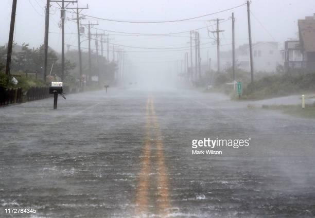 Water floods Highway 12 as Hurricane Dorian hits the area on September 6, 2019 in Nags Head, North Carolina. Dorian passed Charleston S.C. Yesterday...