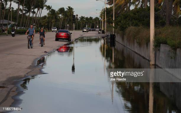 Water floods part of a street that runs near the Strait of Florida during the seasonal king tides on October 26, 2019 in Key West, Florida....