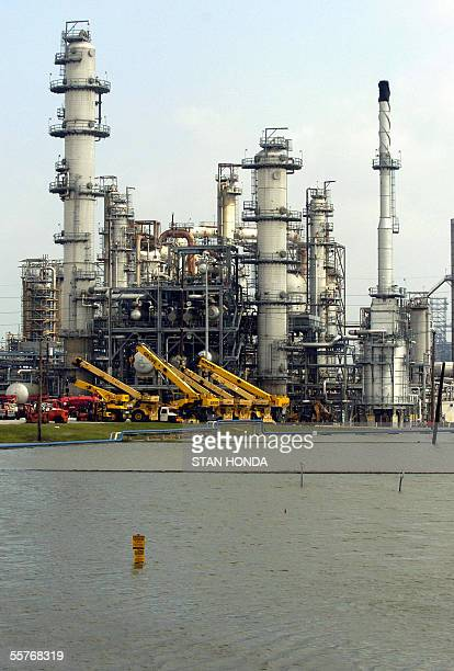 Water floods the Motiva Oil Refinery 25 September 2005 in Port Arthur Texas in the aftermath of Hurricane Rita The US oil industry still reeling from...