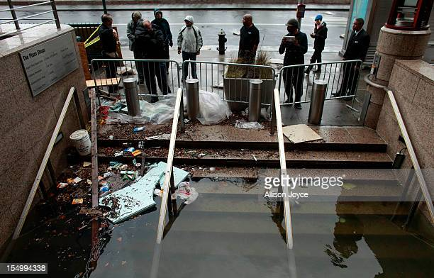 Water floods the Plaza Shops October 30 2012 in lower Manhattan New York The storm has claimed at least 33 lives in the United States and has caused...