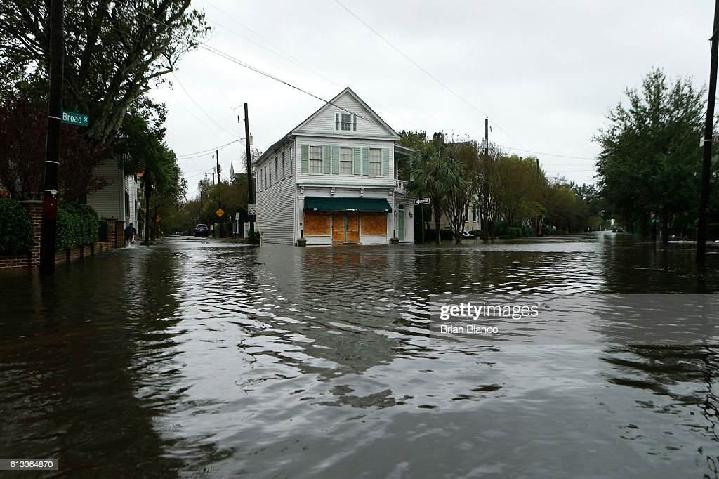 Water floods the streets on and around Broad Street in the wake of Hurricane Matthew on October 8, 2016 in Charleston, South Carolina. Across the Southeast, Over 1.4 million people have lost power due to Hurricane Matthew which has been downgraded to a category 1 hurricane on Saturday morning.