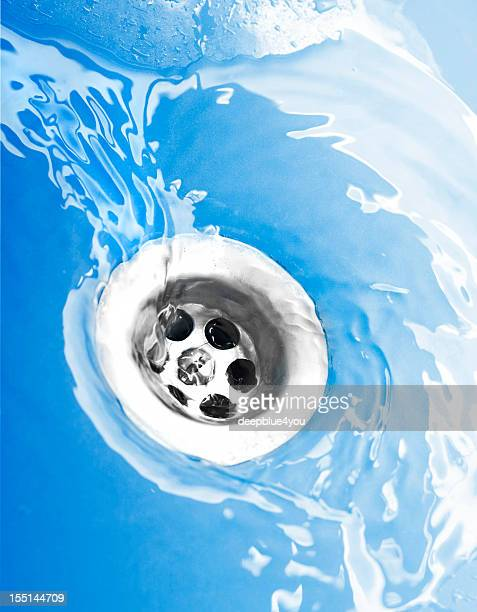 water flowing down the drain - sewer stock pictures, royalty-free photos & images
