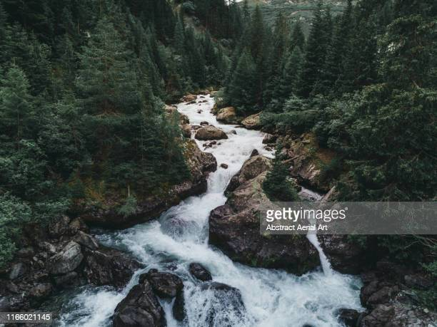 water flowing from lai da marmorera reservoir - rivier stockfoto's en -beelden