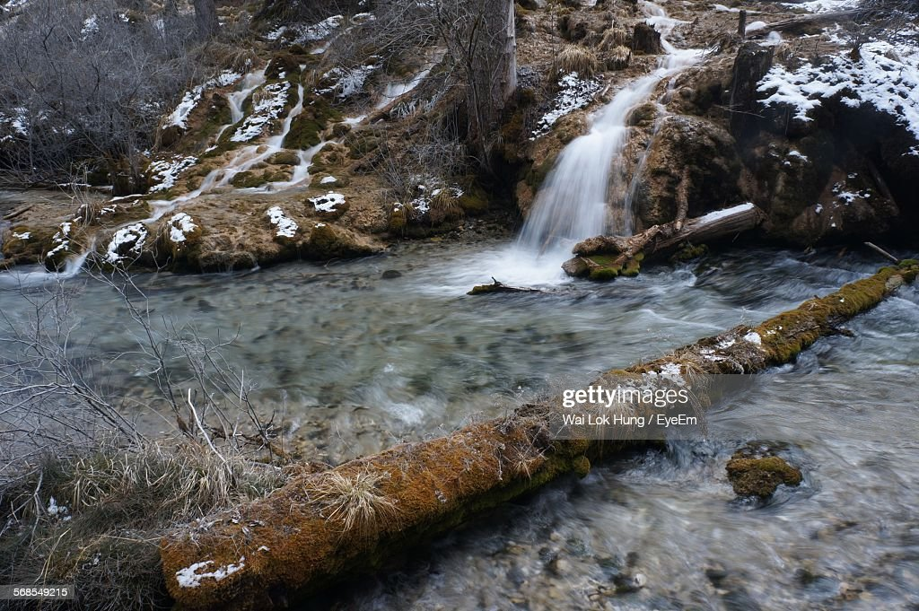 Water Flowing From Mountains By River : Stock Photo