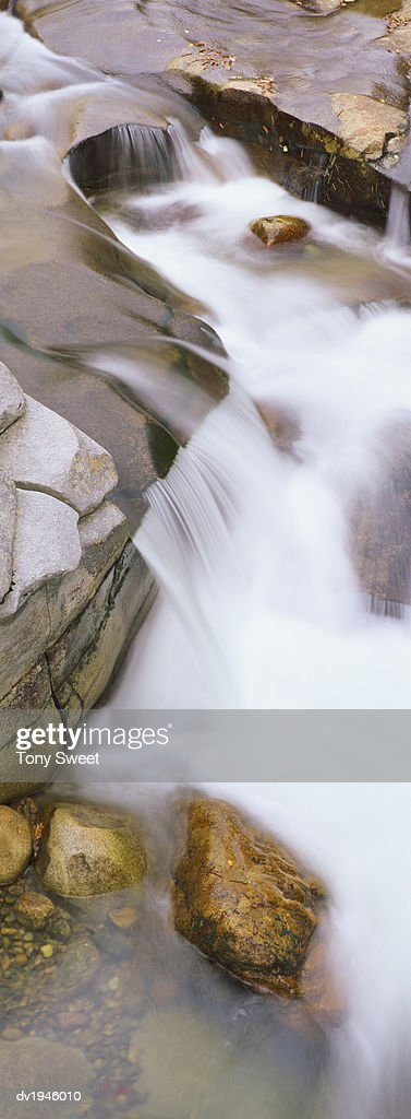 Water Flowing on a Riverbed : Stock Photo