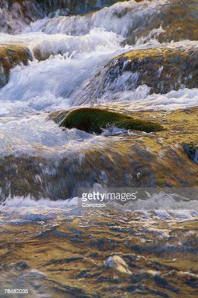 water flowing over rocks - havasu creek stock photos and pictures