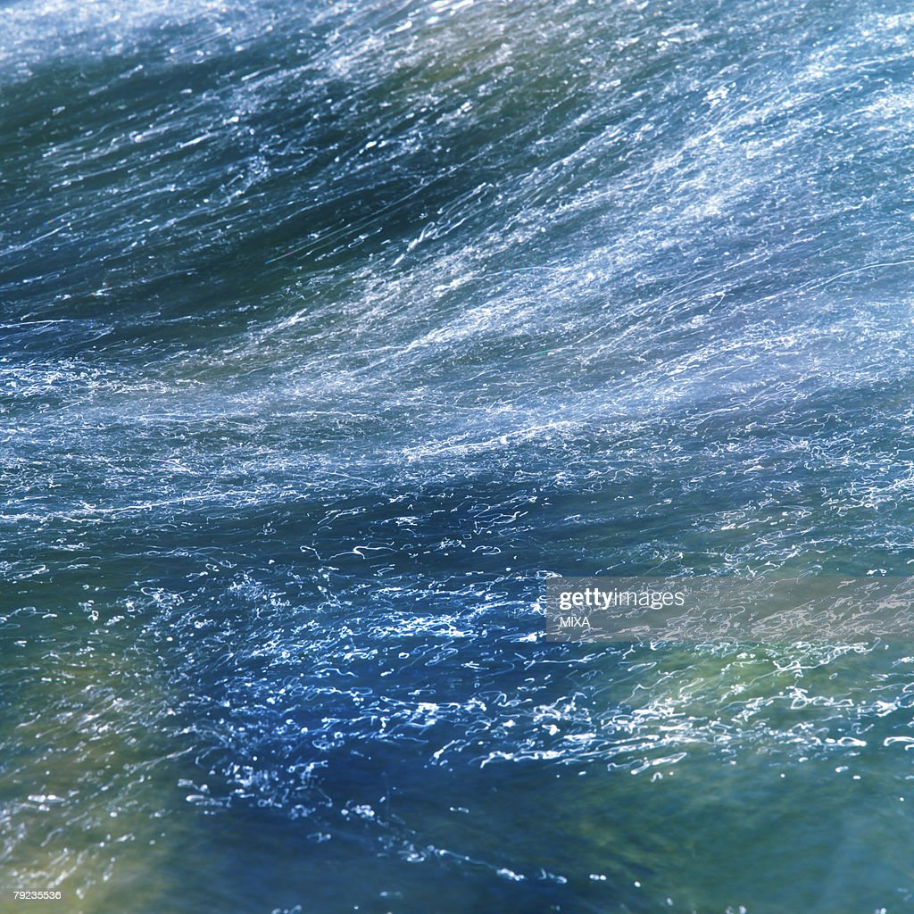 Water flowing rapidly in stream : Stock Photo