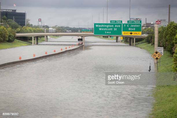 Water flows down Interstate 10 which has been inundated with flooding from Hurricane Harvey on August 27 2017 in Houston Texas Harvey which made...
