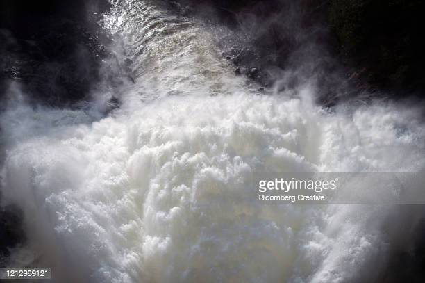 water flows from a dam - releasing stock pictures, royalty-free photos & images