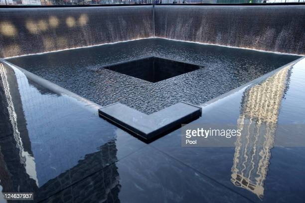 Water flows in a 9/11 Memorial pool during the tenth anniversary ceremonies of the September 11 2001 terrorist attacks at the World Trade Center site...