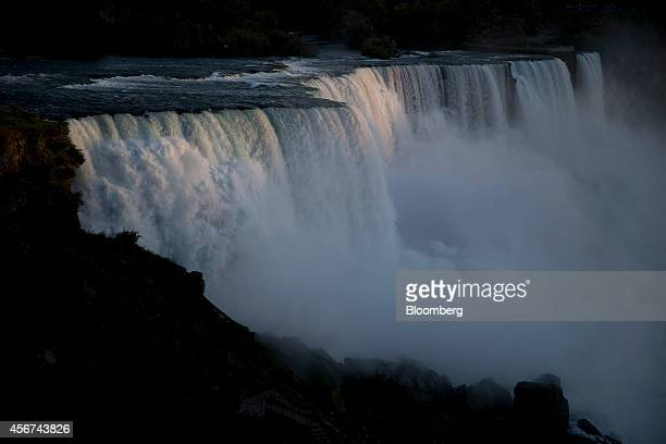 Water flows over the American Falls in Niagara Falls New York US on Thursday Sept 25 2014 The Niagara Falls State Park established in 1885 saw a 19...