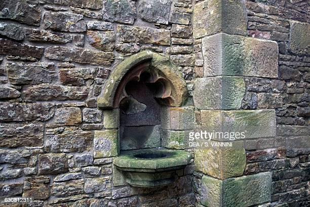 Water font chapel of Bolton Castle near Leyburn North Yorkshire England United Kingdom 14th century