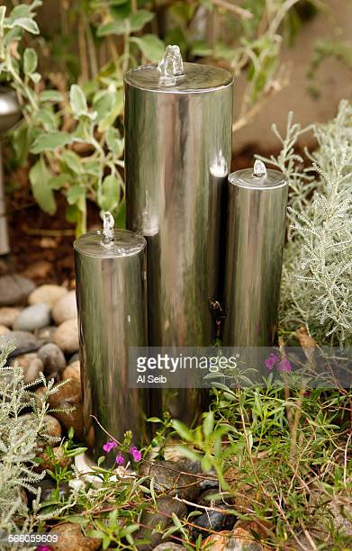 A water fountain adds a contemporary feels to th backyard of Randy Bergman's home in the Cheviot Hills neighborhood of Los Angeles Bergman's front...