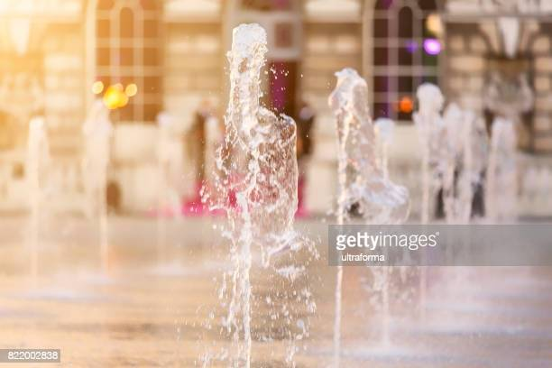 water fountain jets arranged in a row in london - fountain stock pictures, royalty-free photos & images