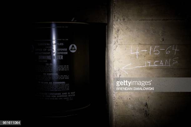 Water from 1964 is seen stored in a former Civil Defense fallout shelter beneath the OysterAdams School April 17 2018 in Washington DC In a...