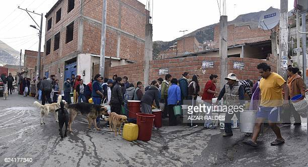 Water from a tanker is rationed for free in a neighbourhood of La Paz on November 18 2016 as the worst drought in over 25 years in Bolivia is...