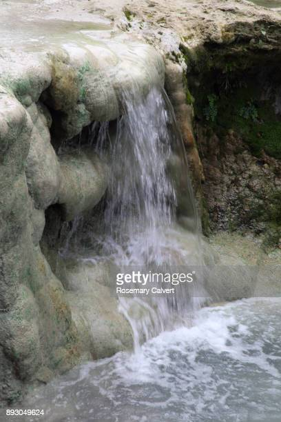 Water from hot spring creating waterfall, Tuscany,Italy.