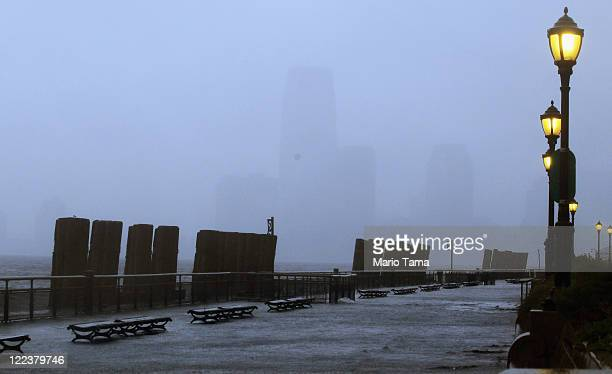 Water from New York Harbor washes over a sidewalk in Battery Park on August 28 2011 in New York City Hurricane Irene made landfall in the vicinity of...