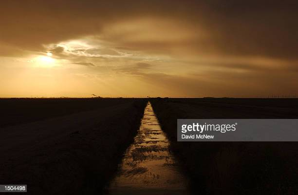Water from the Colorado River moves along an irrigation canal October 17, 2002 near El Centro, California. Southern California water authorities have...