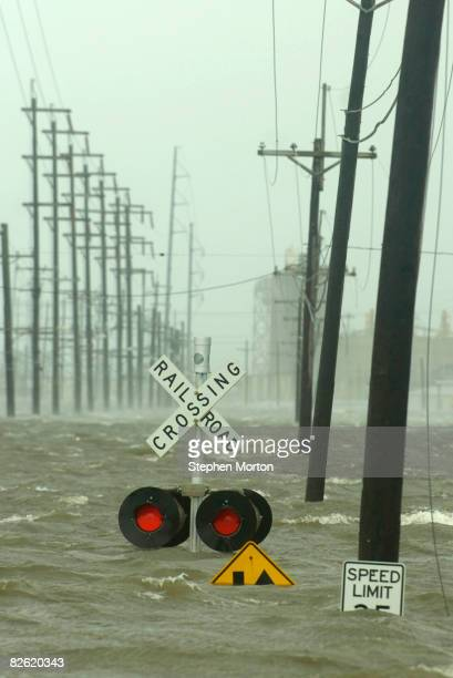 Water from the industrial canal floods a road as Hurricane Gustav strikes the Gulf Coast September 1, 2008 in New Orleans, Louisiana. Gustav made...