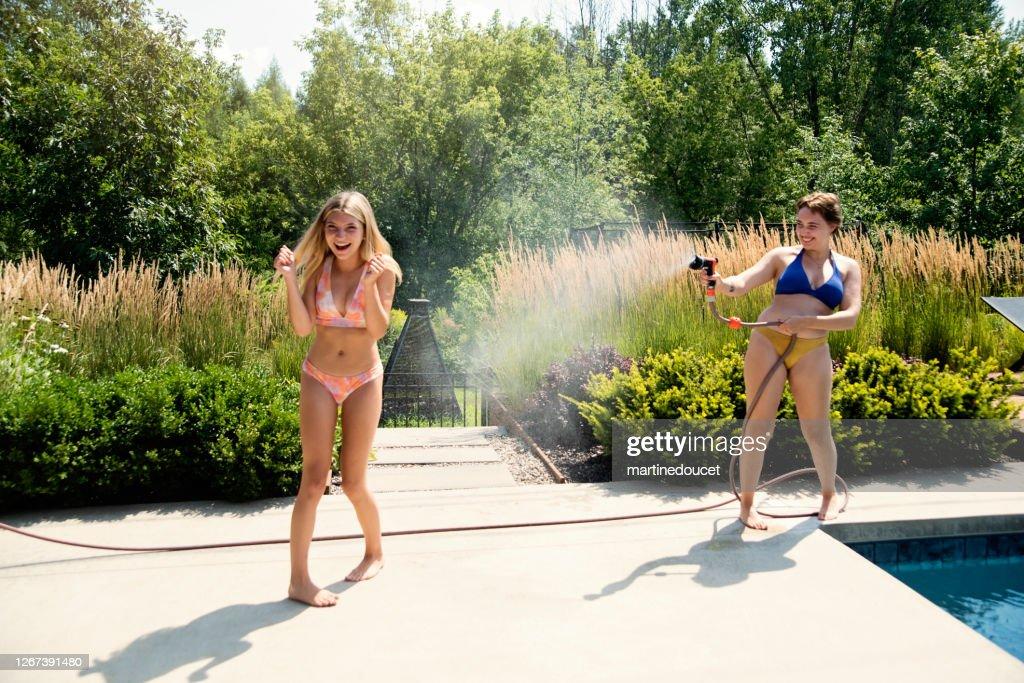 Water fun for two cousins in backyard. : Stock Photo