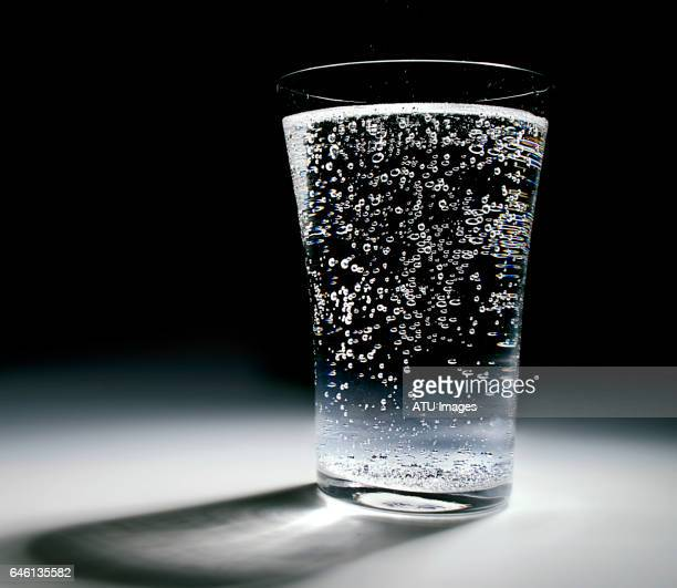 water glass spotlight - carbonated water stock pictures, royalty-free photos & images