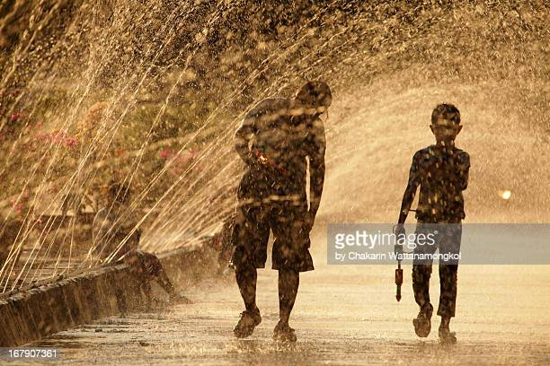water gunman : songkran festival - buddhist new year stock pictures, royalty-free photos & images