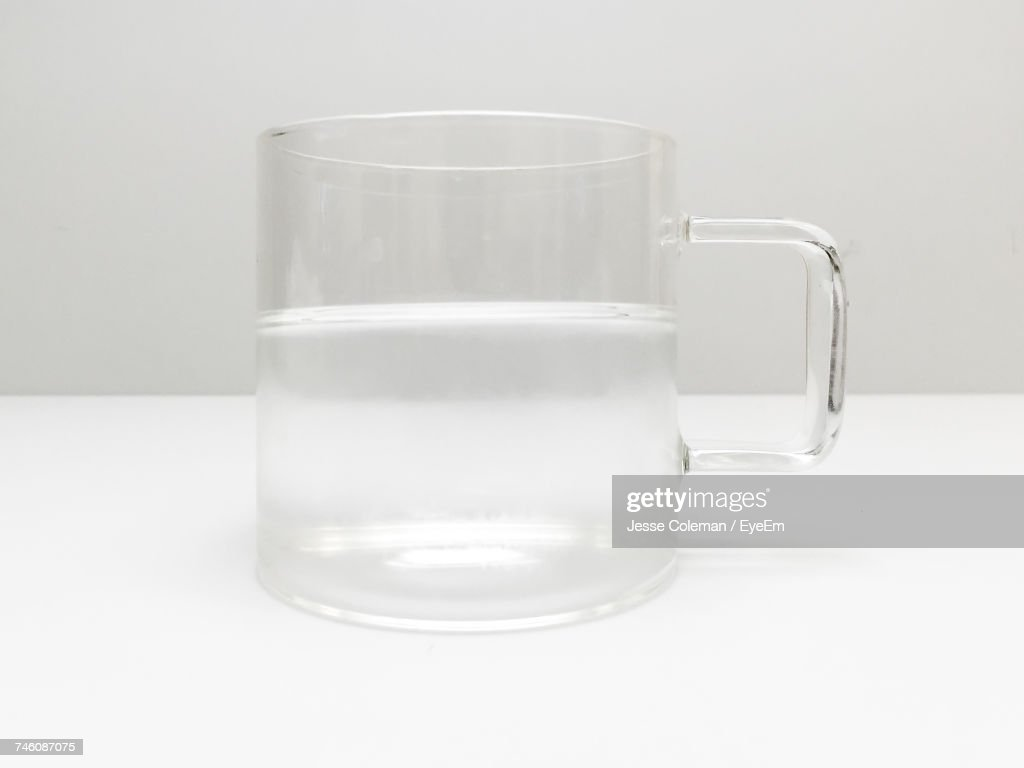 Water In Cup On White Table : Stock Photo