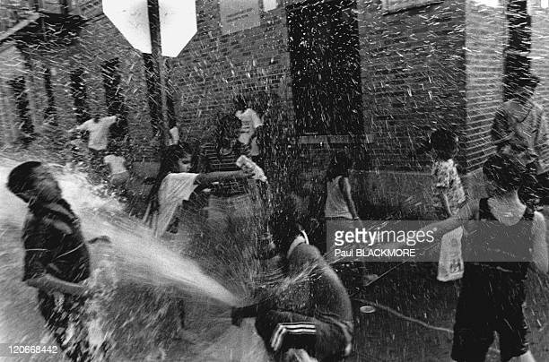 Water in New York United States Kids playing with the water of a fire hydrant in the Bronx