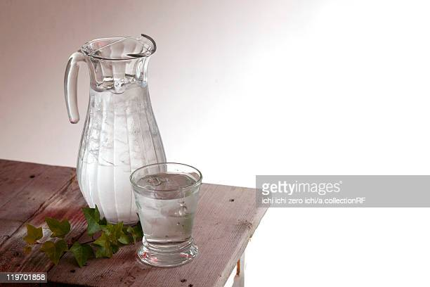 Water in pitcher on side table
