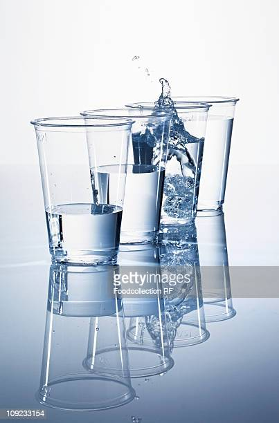 Water in plastic cups, close-up