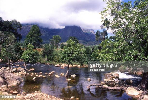 Water in stream flowing from Mulanje Massif in distance southern Malawi Africa