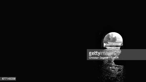 water in tunnel - light at the end of the tunnel stock pictures, royalty-free photos & images
