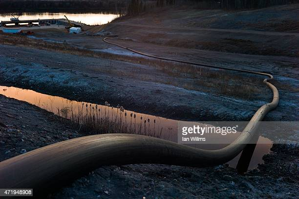 A water intake pipe for oil sands operations leads downhill to the Athabasca River on April 28th 2015 north of Fort McMurray Canada Fort McMurray is...