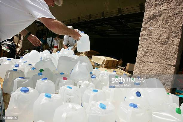 D'IBERVILLE MS SEPTEMBER 06 Water is available at a relief distribution site September 6 2005 in D'Iberville Mississippi The death toll stands at 160...