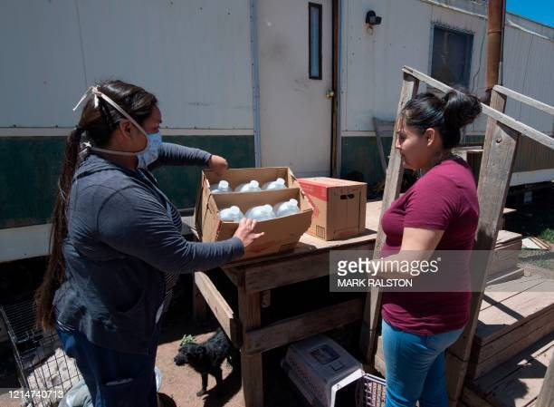Water is delivered by staff of the John Hopkins Center for American Indian Health at a home with no running water, near the Navajo Nation town of...