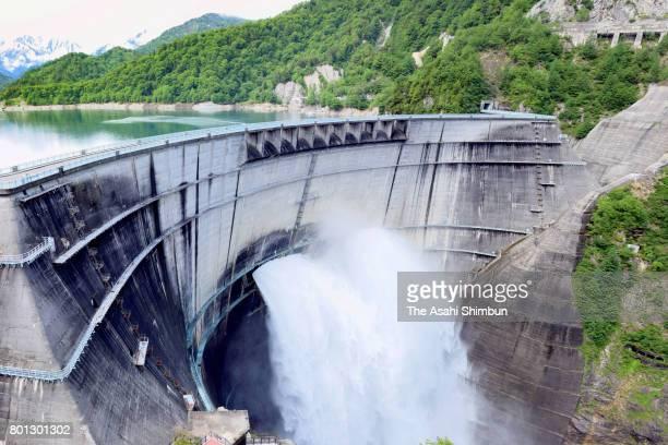 Water is discharged from Kurobe Dam for spring tourist season on June 26 2017 in Tateyama Toyama Japan